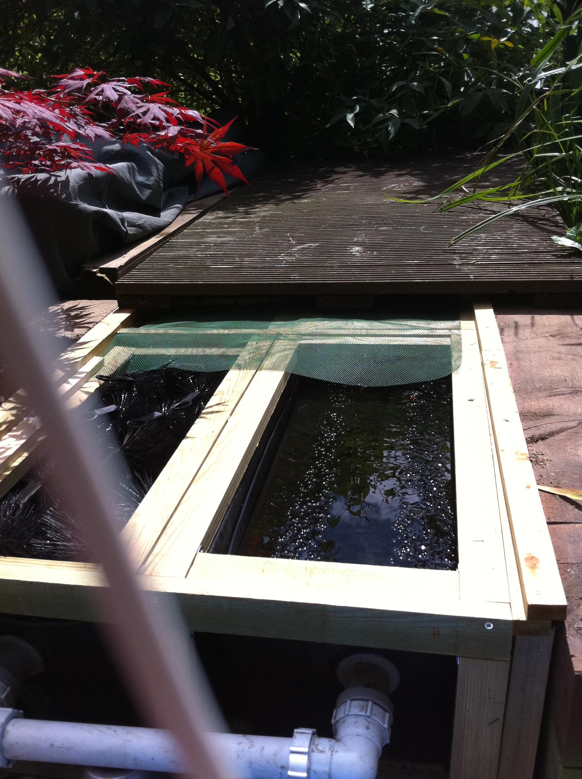 Pond and aquarium design installation and for Gravity fed koi pond design